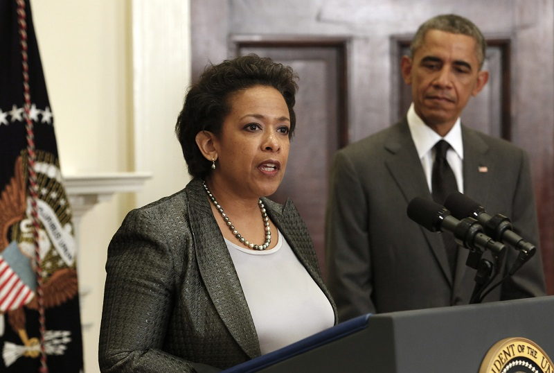 US Attorney General nominee Loretta Lynch speaks next to US President Barack Obama in the Roosevelt Room at the White House in Washington DC on 8 November 2014