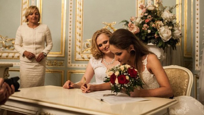 Irina Shumilova and Alyona Fursova were allowed to marry despite Russia's ban on gay marriage because according to their passports one is a man and the other is a woman