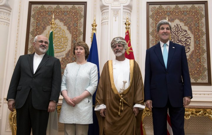 (L-R) Iranian Foreign Minister Javad Zarif, EU envoy Catherine Ashton, Omani Foreign Minister Yussef bin Alawi and U.S. Secretary of State John Kerry pose for a photo in Muscat