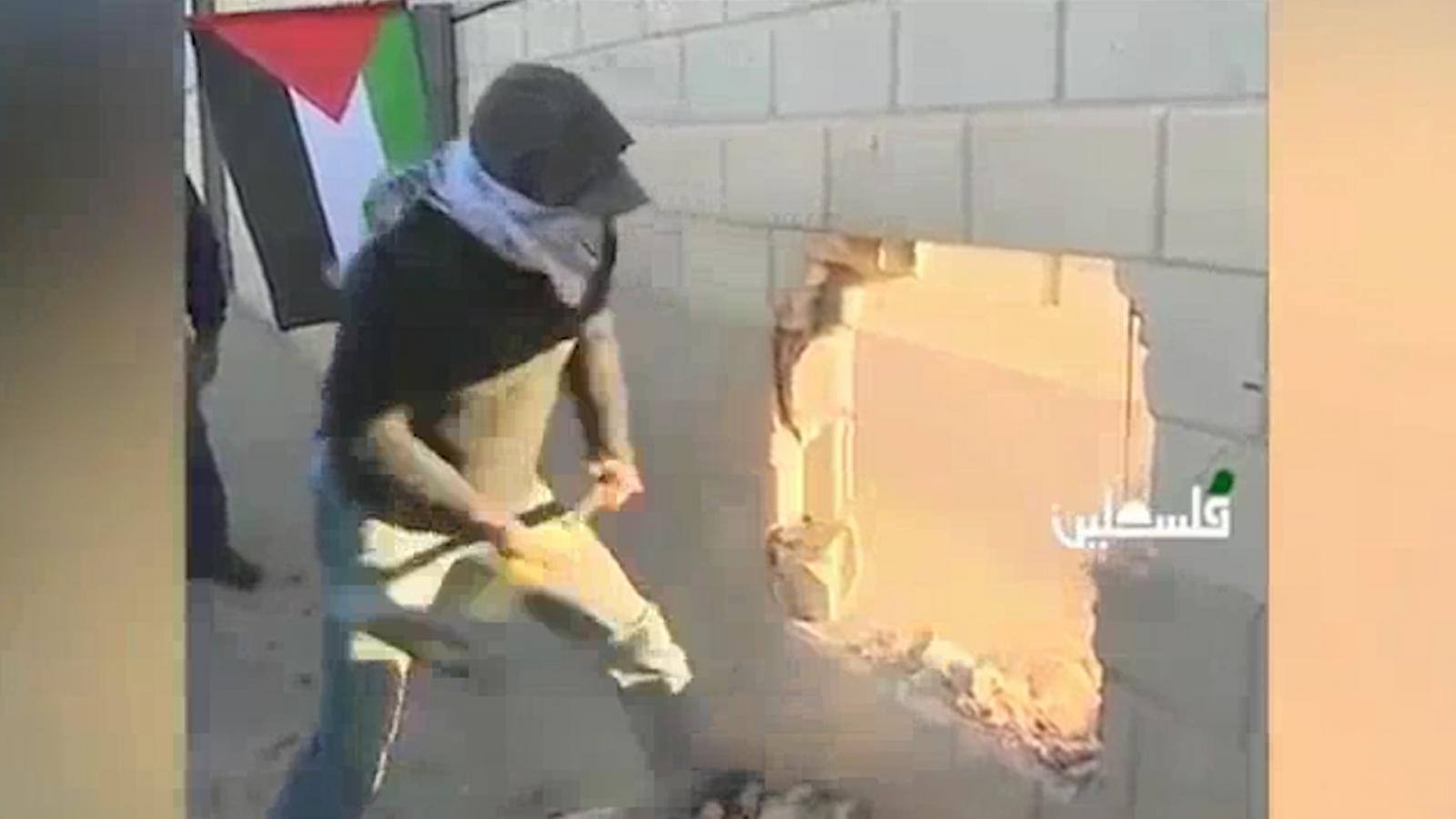 Palestinian Youths Break Through Israeli Partition on Berlin Wall Anniversary