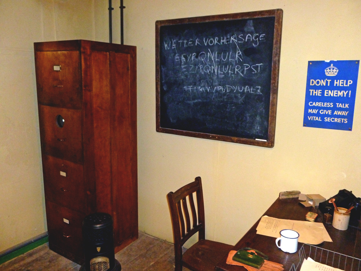 An office in one of the huts, showing a black board where a message is being decrypted