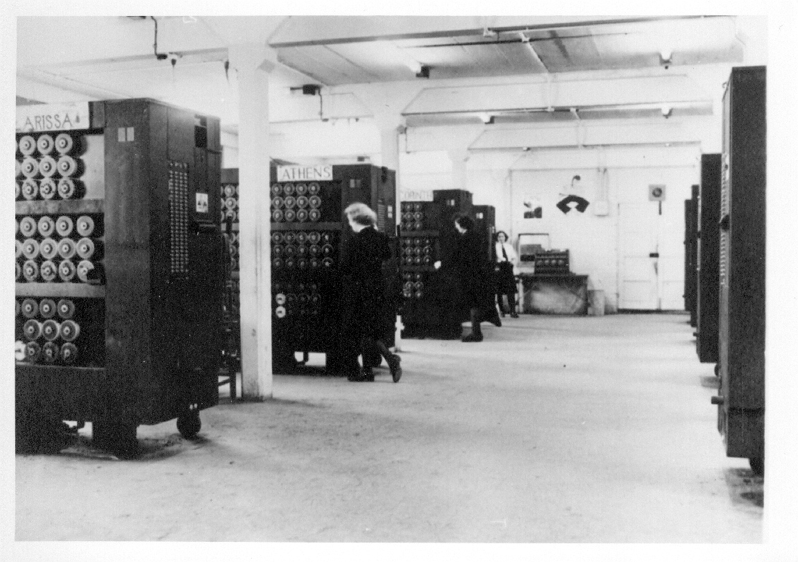 Rows of Bombe machines at work in Bletchley Park