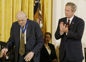 President George W Bush applauds Peter Drucker