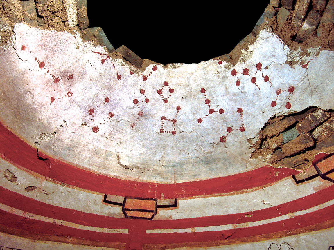 The curved ceiling of the circular tomb, which features constellations of stars painted in red