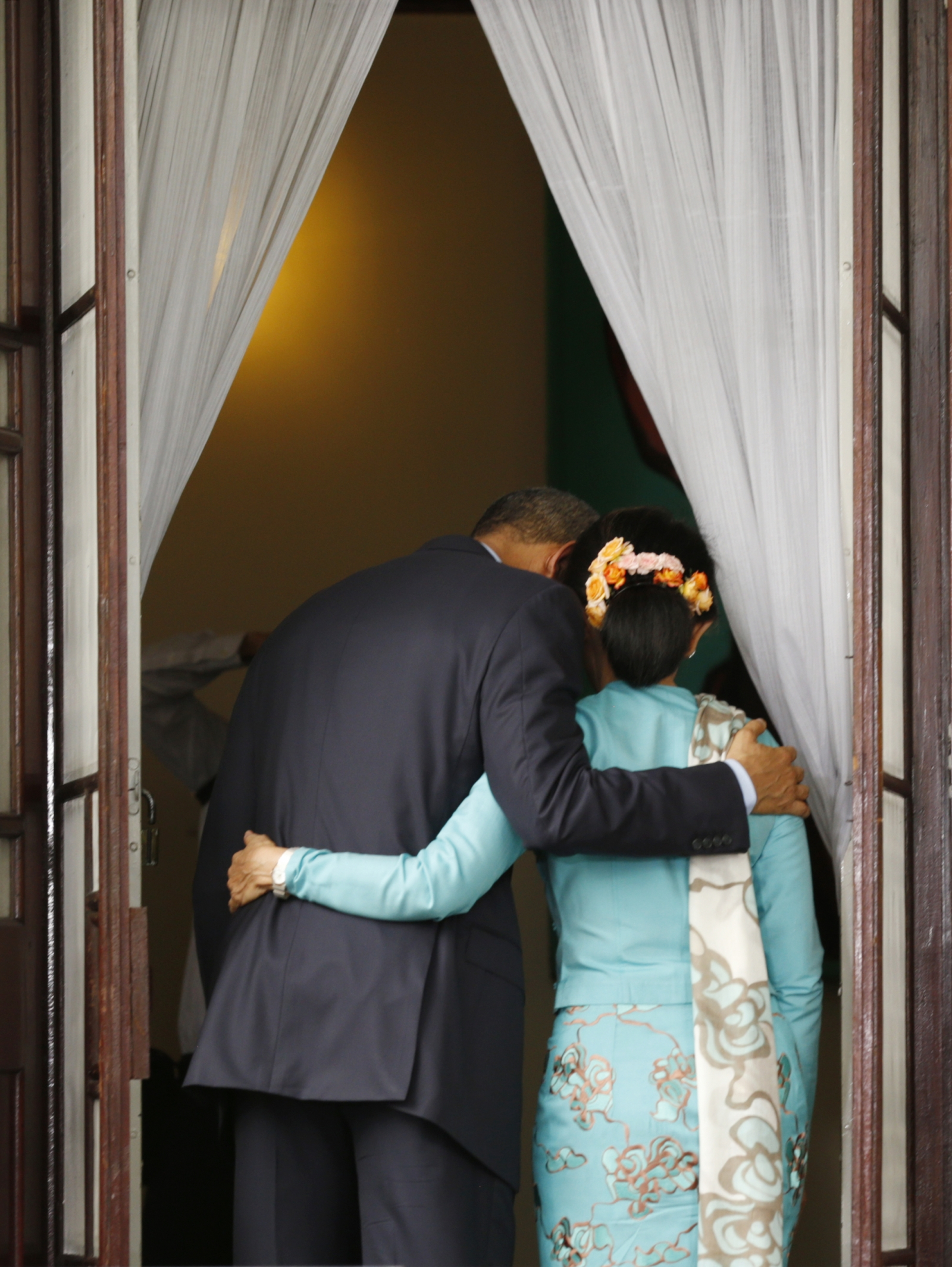 U.S. President Barack Obama puts his arm around opposition politician Aung San Suu Kyi after a joint press conference following their meeting at her residence in Yangon