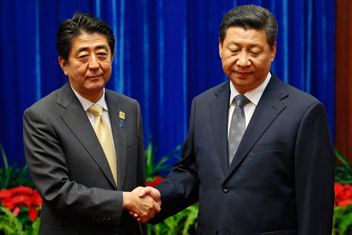 xi abe japan china handshake