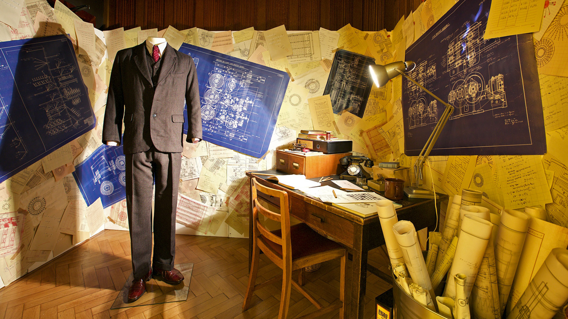 One of the suits worn by Benedict Cumberbatch in his role as Alan Turing, and the recreation of Turing's desk