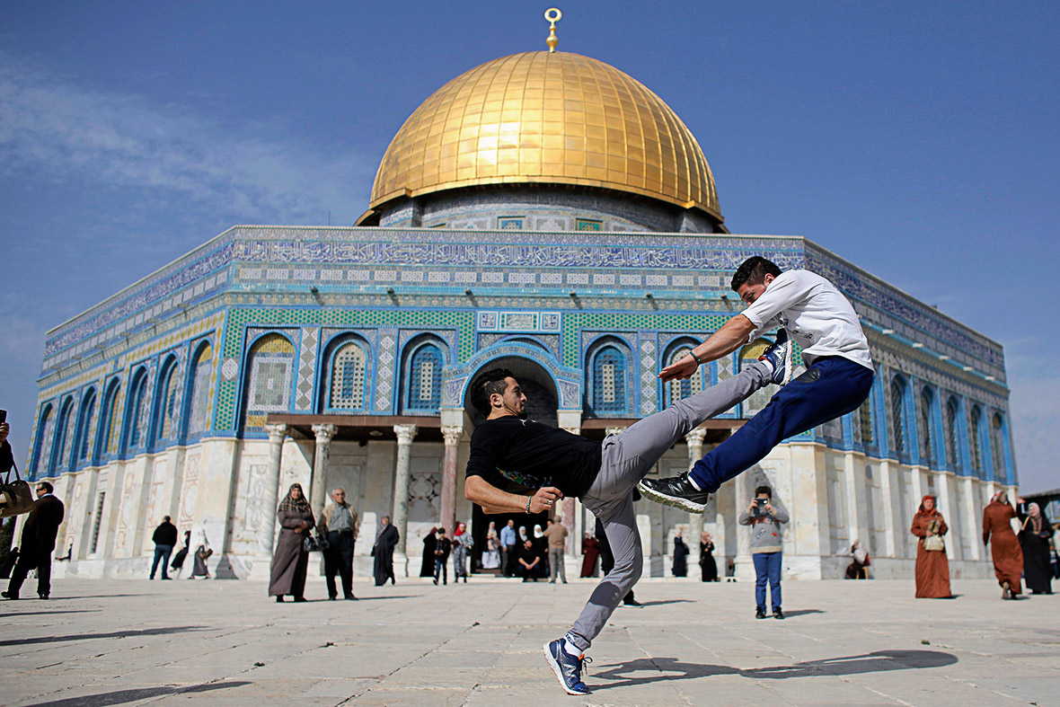 Palestinian youths practise their parkour skills during Friday prayers at the Dome of the Rock in Jerusalems Old City