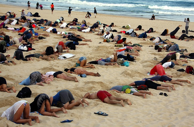 protesters bury heads in sand