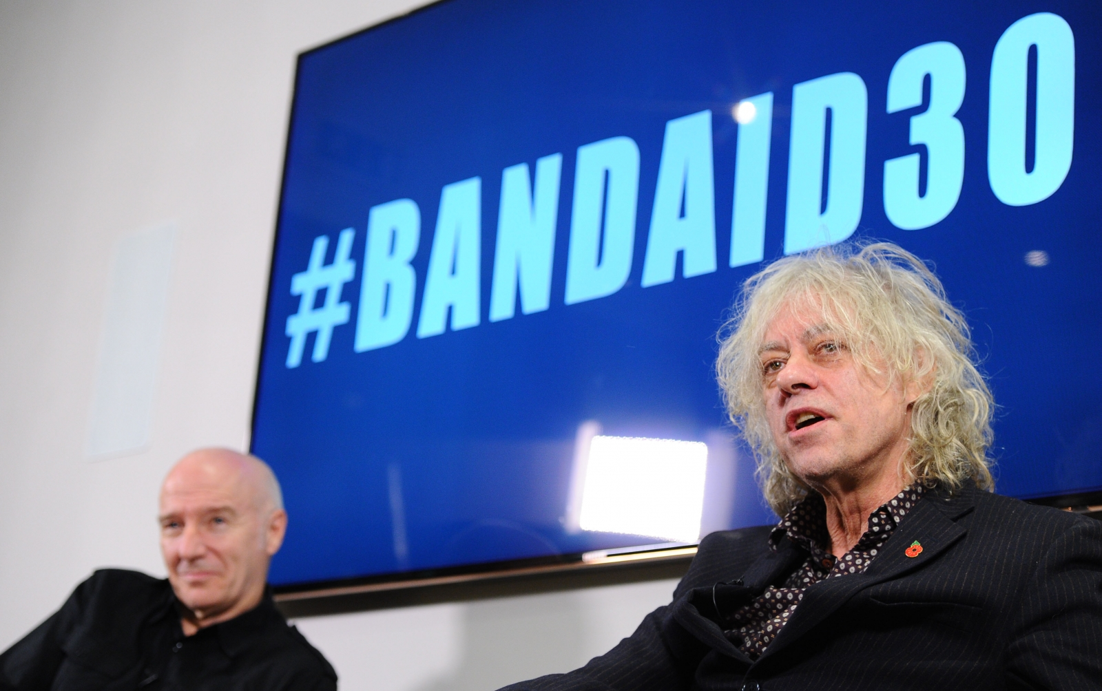 Midge Ure and Sir Bob Geldoff discuss Band Aid 30 at a press conference this week. (Getty)