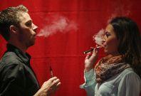 Smoking e-cigarette with cannabis liquid