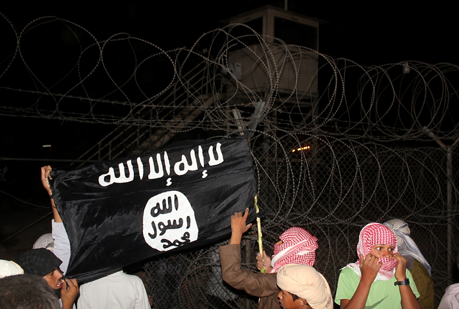 Protesters in Sinai hold aloft the Isis flag. (Getty)
