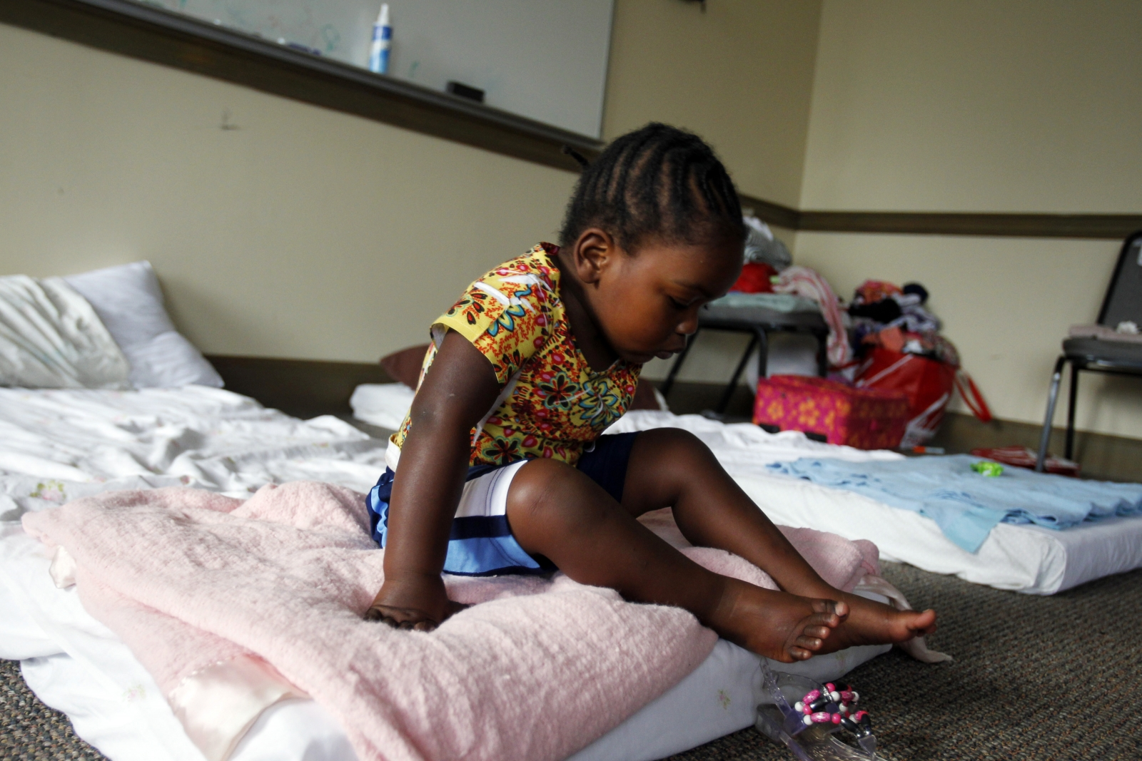 Two-year-old girl at the Covenant Presbyterian Church temporary shelter in Charlotte, North Carolina