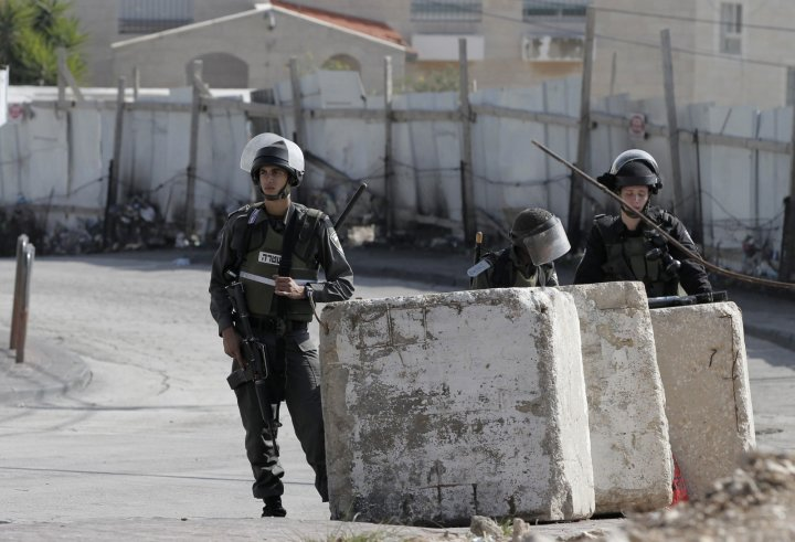 Israeli forces guard the homes of the two suspected synagogue attackers in Jabal al-Mukabbir, east Jerusalem (Getty)