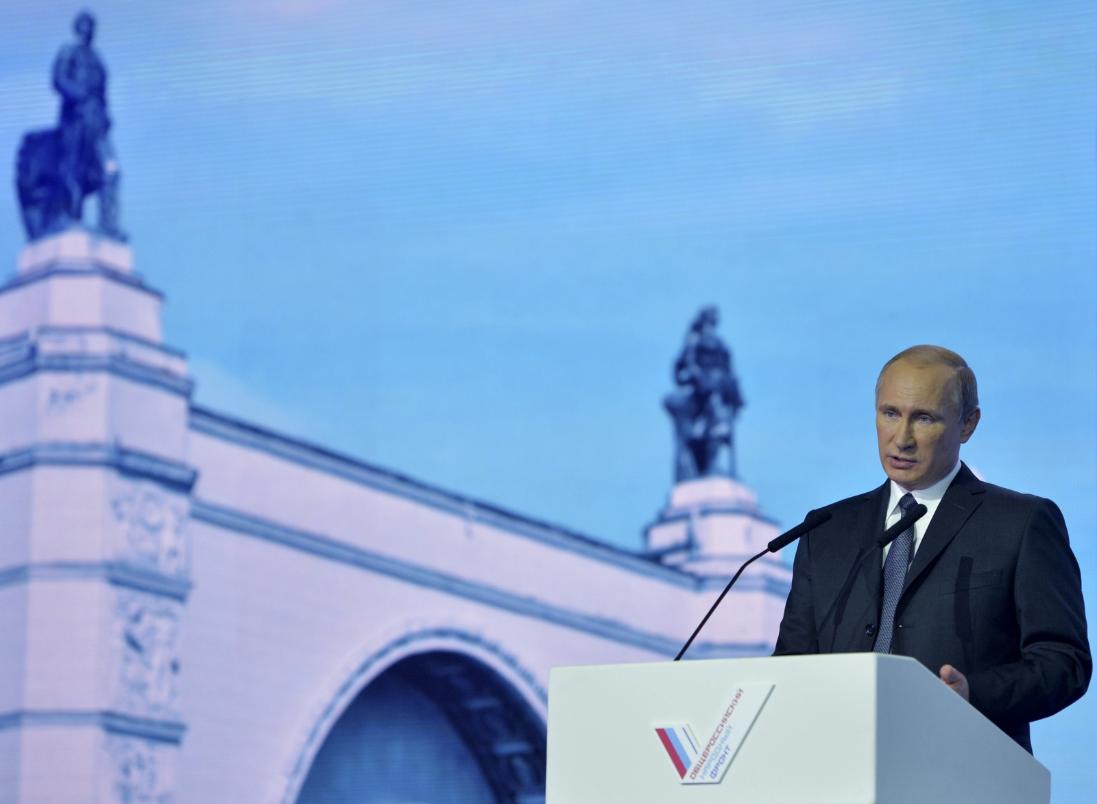 Putin delivers his speech in Moscow today at a meeting of the All-Russia People's Front (Reuters)