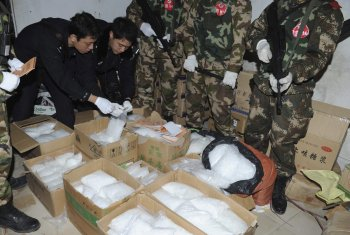 Police check seized crystal meth at Boshe village, Lufeng, Guangdong province