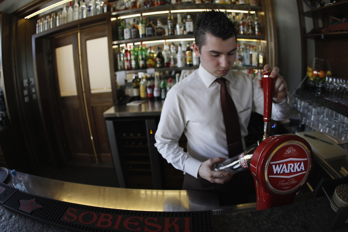 A bartender pours local beer at the Sielanka nad Pilica Hotel in Warka