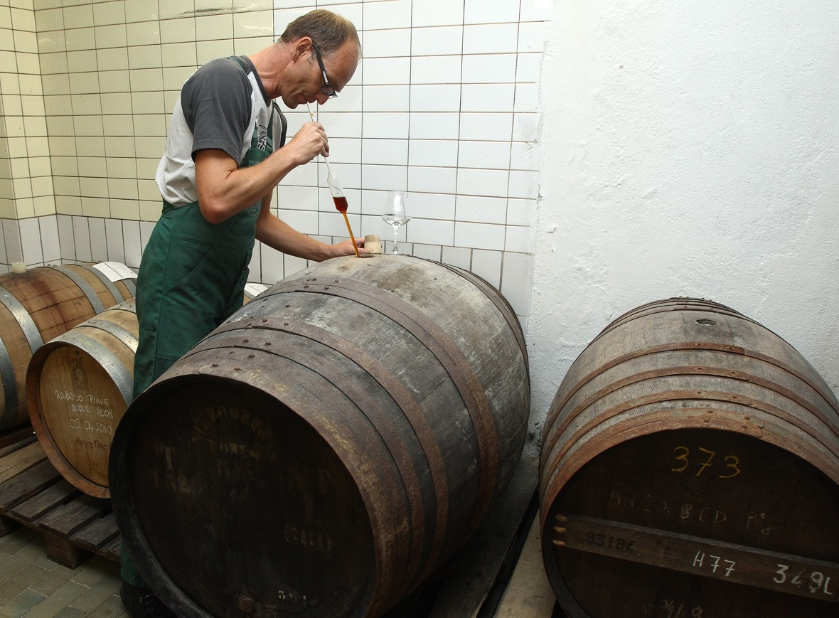 Austrian brewer Peter Krammer tries a sample of aging beer in his family-owned Hofstetten brewery in the Upper Austrian town of Saint Martin.