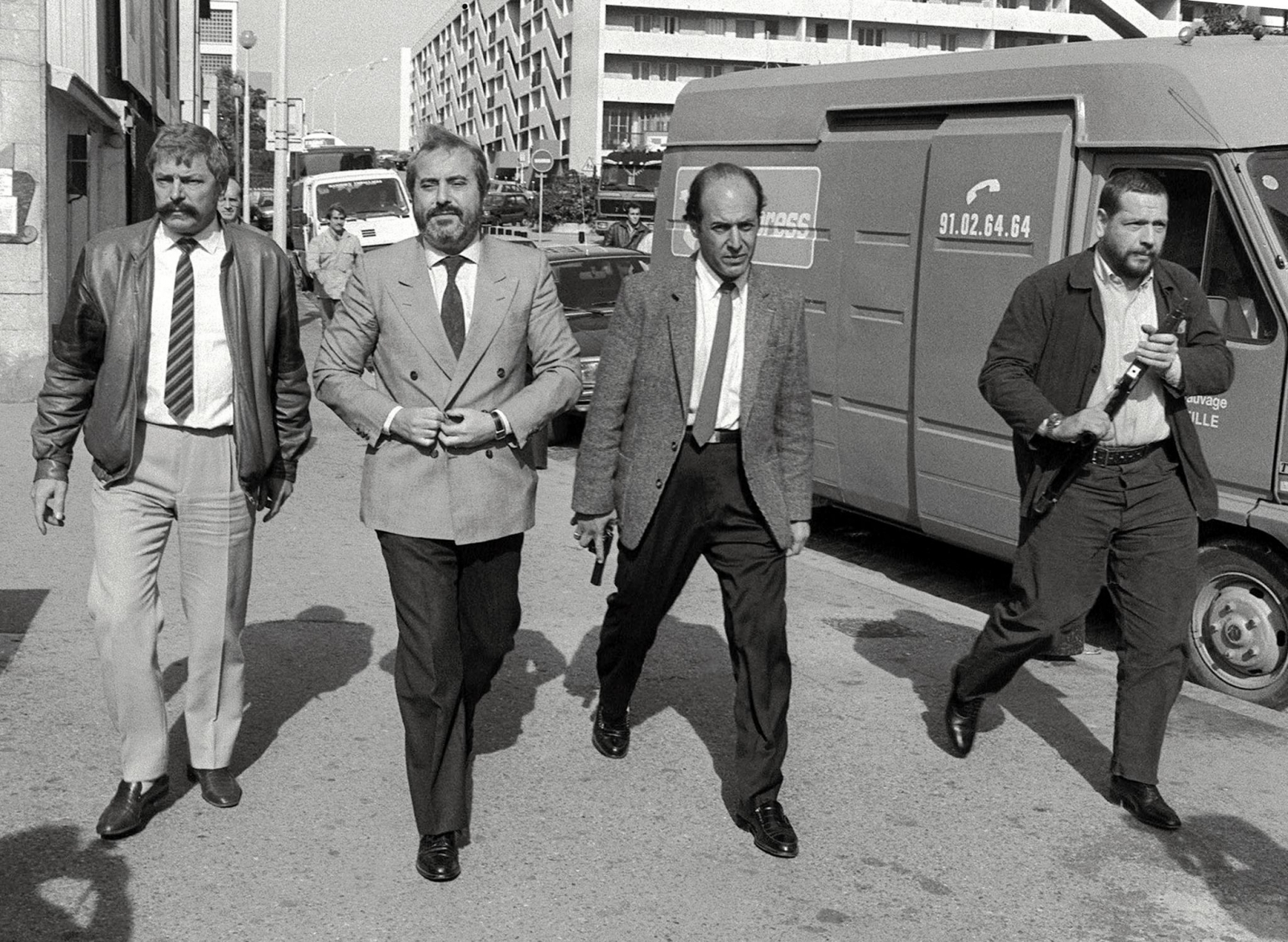 Giovanni pictured in 1986 flanked by bodyguards. Six years later he was dead, assassinated by the Sicilian  mafia. (Getty)