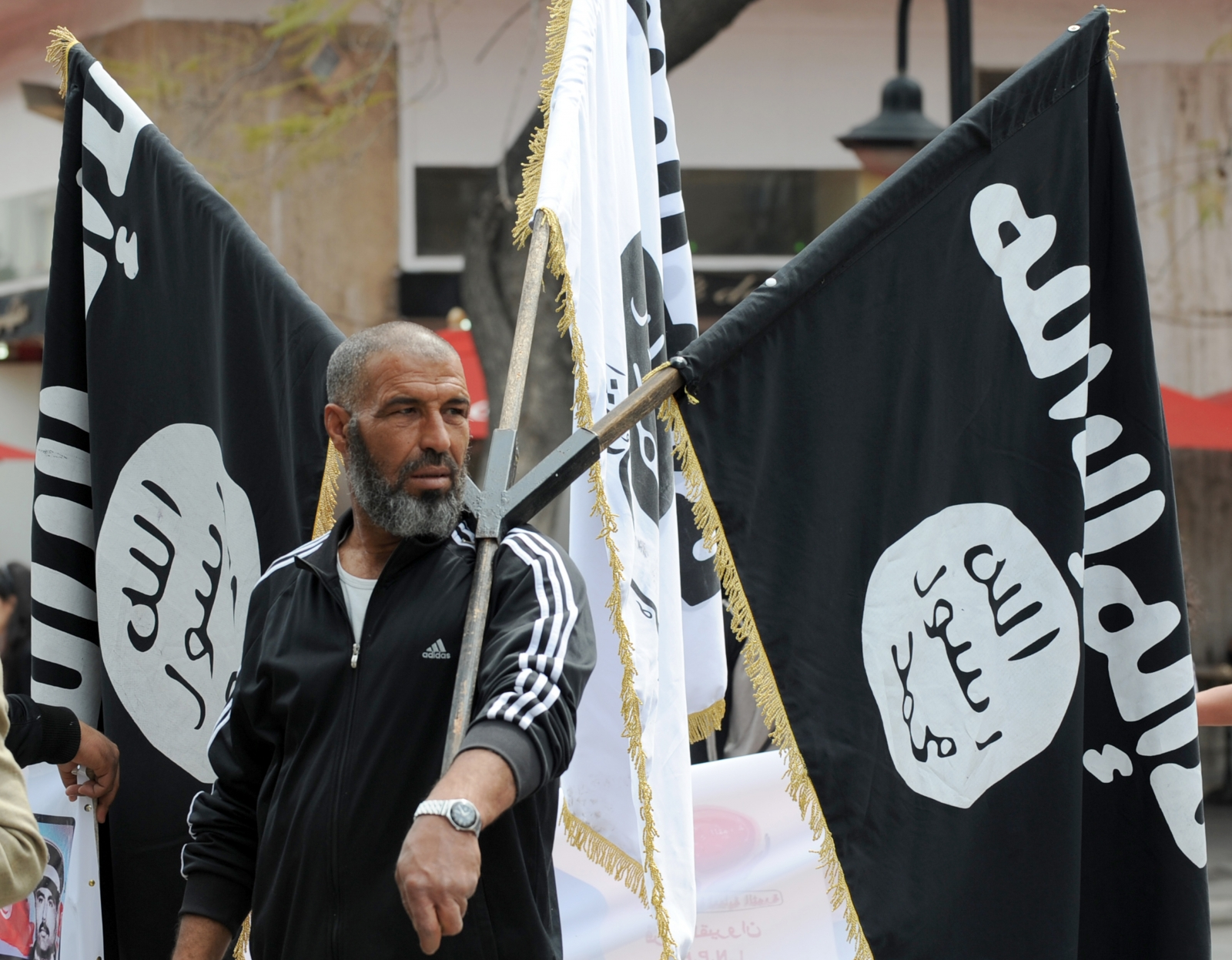 An Islamist holds aloft the Isis flag at a demonstration in Tunis. (Getty)