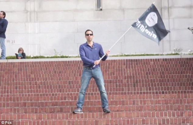 Filmaker Ari Horowitz waves the Isis flag on Berkeley campus. (YouTube)