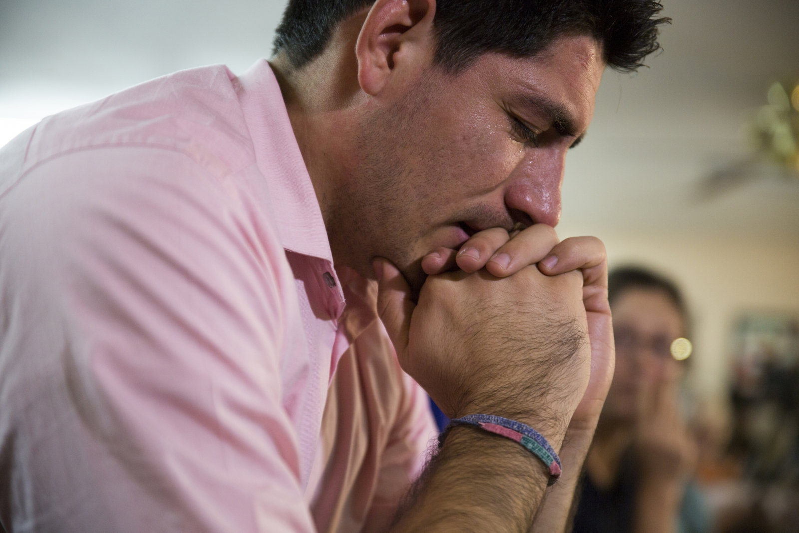 Jose Patino, a DREAMer, becomes emotional while watching U.S. President Barack Obama's national address in Phoenix