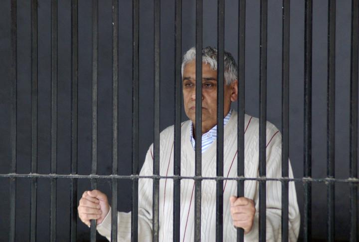 Satguru Rampalji Maharaj in police custody, after being arrested in relation with a 2006 murder case. (Reuters)