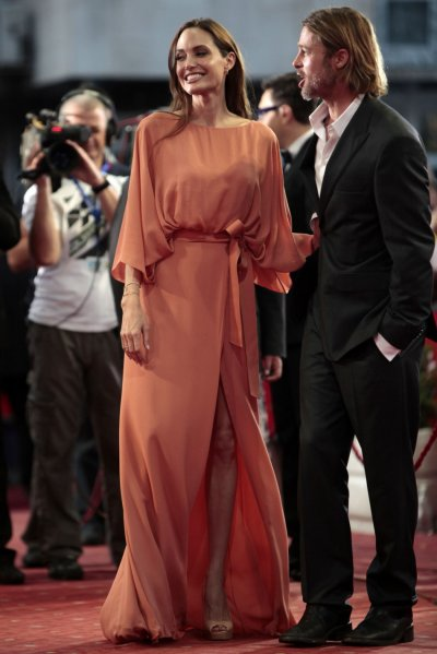 Angelina Jolie L and Brad Pitt arrive on the red carpet on the final night of the 17th Sarajevo Film Festival