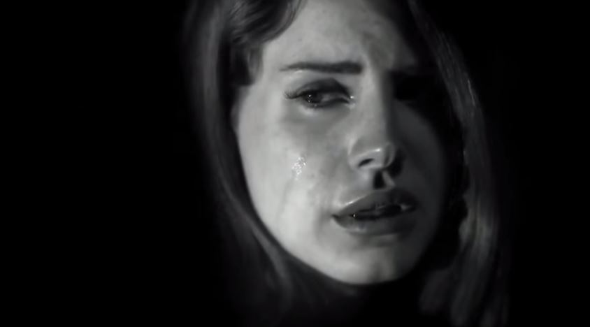 Still from graphic video depicting singer Lana Del Rey in a harrowing rape scene
