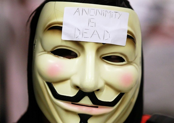 Anonymous protester. The group nhas published the personal details who they claimed ignored information on the innocence of a teen accused of 'swatting'. (Getty)