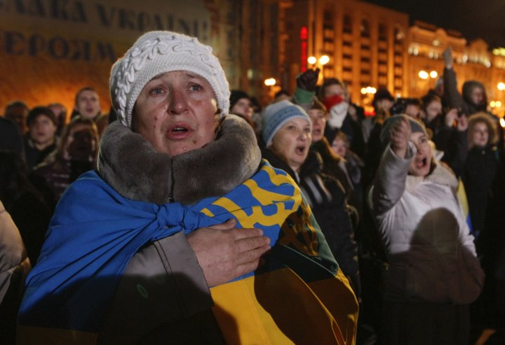 People sing the national anthem as they take part in a rally at the Independence Square in Kiev November 21, 2014