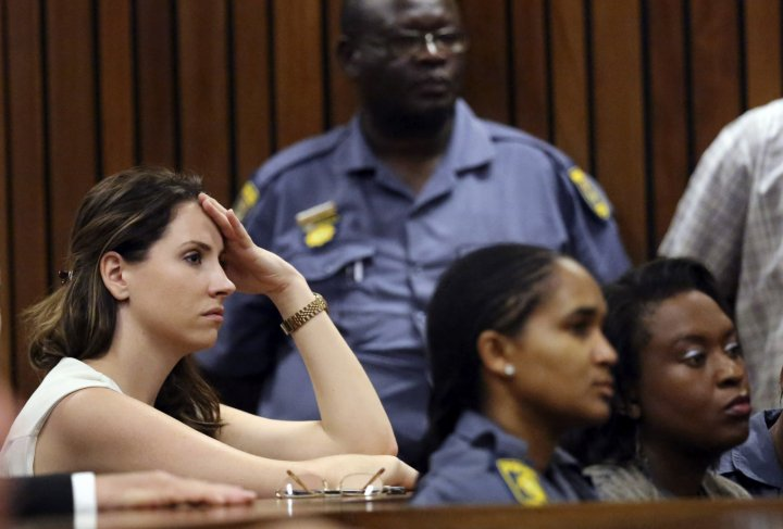 Aimee Pistorius watches as her brother, South African Olympic and Paralympic track star Oscar Pistorius, attends his sentencing at the North Gauteng High Court in Pretoria October 21, 2014