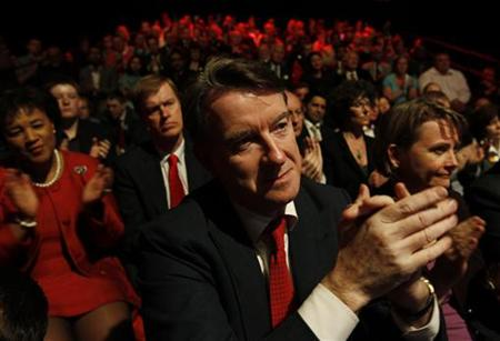 File image shows Business Secretary Mandelson applauding at a Labour Party rally in Manchester