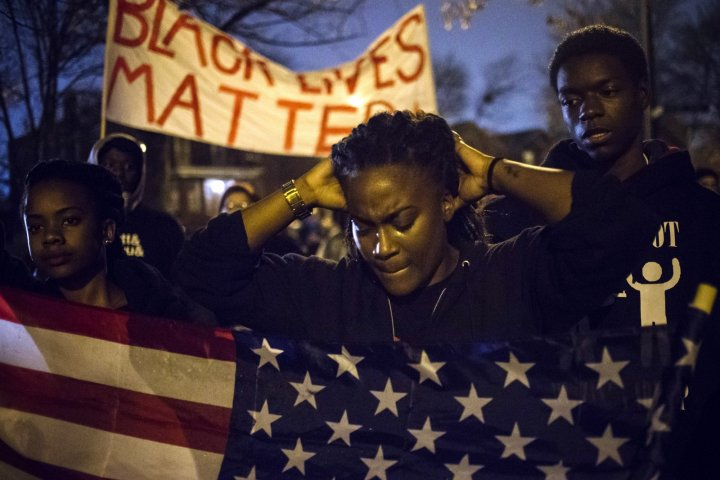 Protesters await the decision of a grand jury whether to indict police officer Darren Wilson
