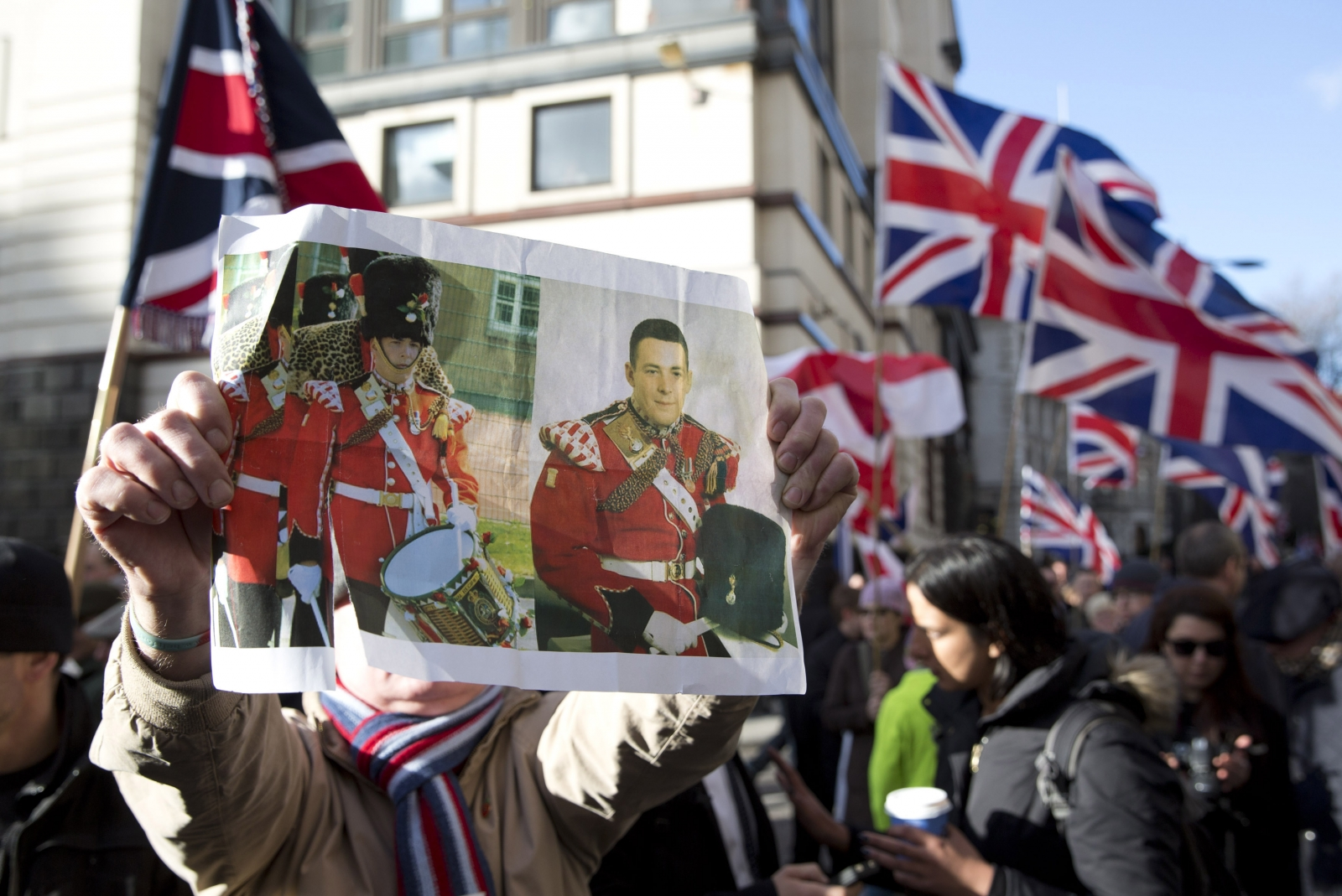 A demonstrator holds a picture of murdered soldier Lee Rigby during a protest