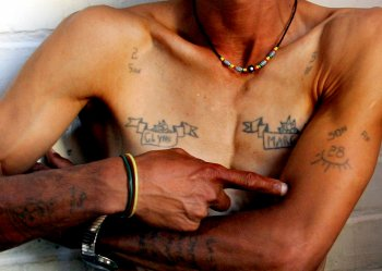 Magadien Wentzel shows his gang tattoos at his home in Mannenberg township near Cape Town