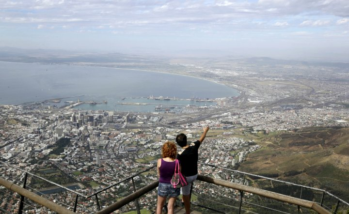 Visitors enjoy the view over the city of Cape Town from the top of Table Mountain