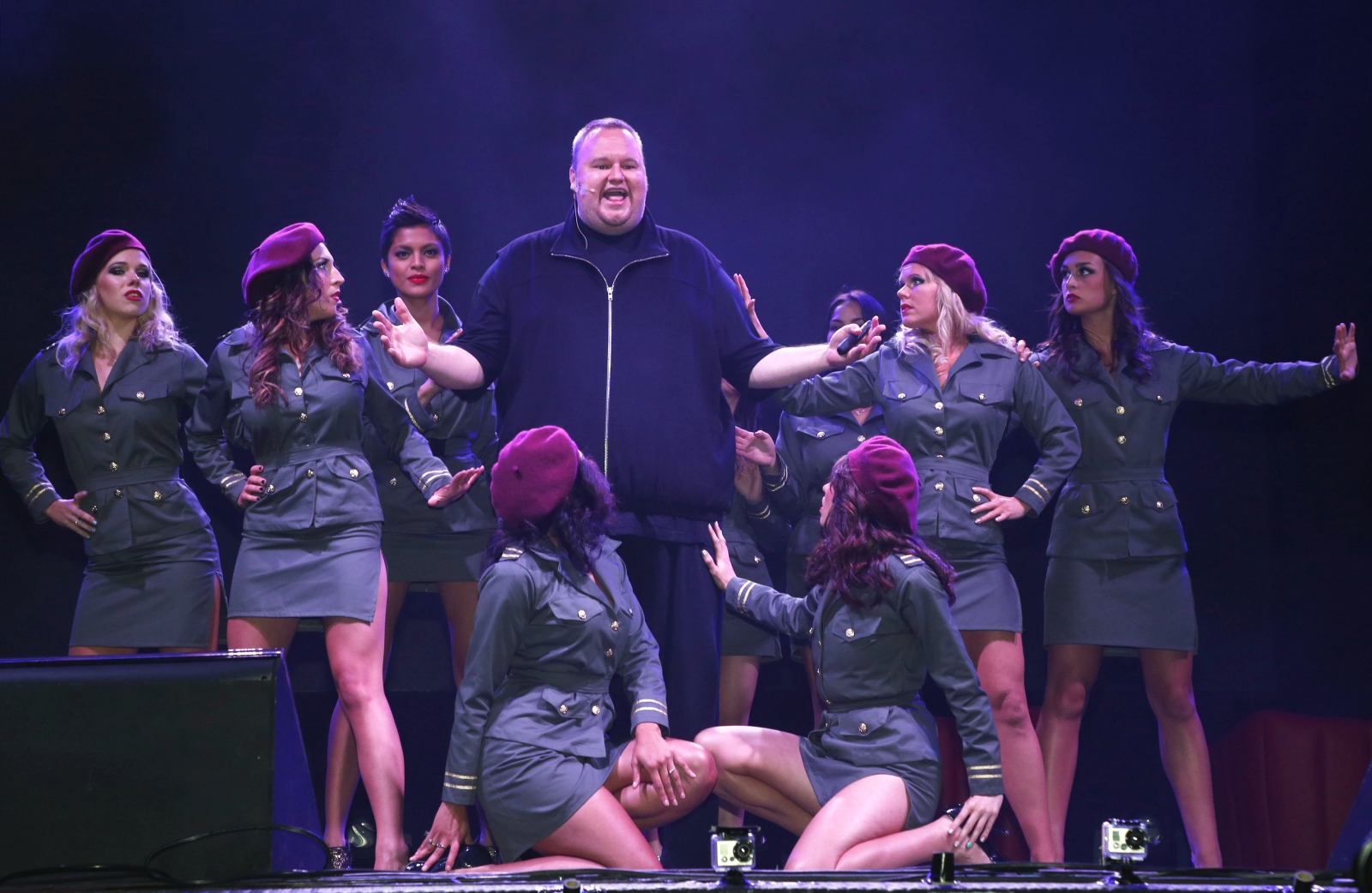 Kim Dotcom in one of his more flamboyant moments, surrounded by dancers at his opening party of Mega