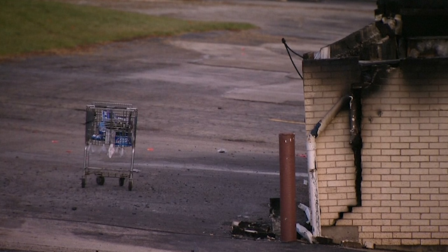 Ferguson Wakes Up to Damaged Buildings and Smouldering Embers after Riots