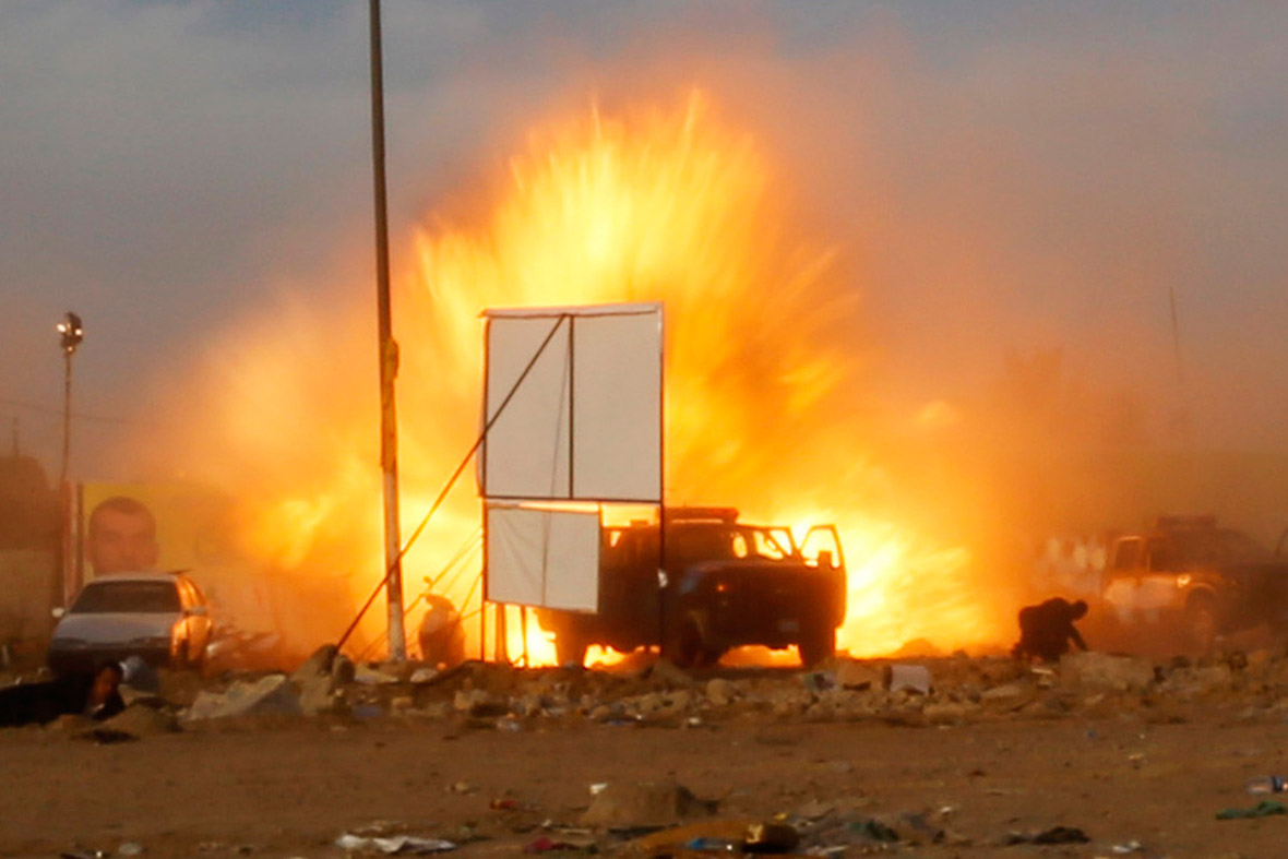 April 25, 2014: An explosion is seen during a car bomb attack at a rally by militant group, Asaib Ahl Haq (League of the Righteous), to introduce its candidates for elections at a football stadium in Baghdad