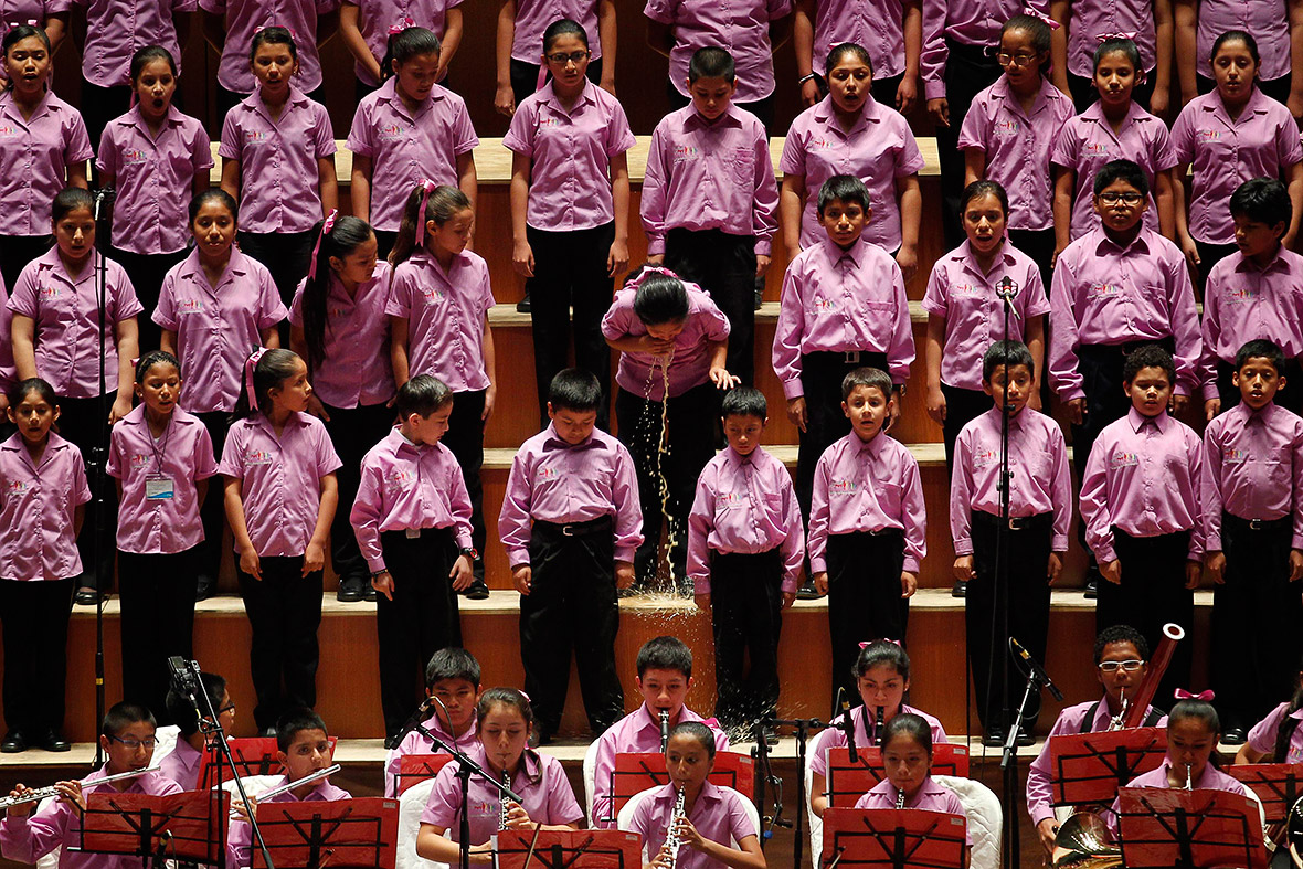 May 13, 2014: A young member of the choir of