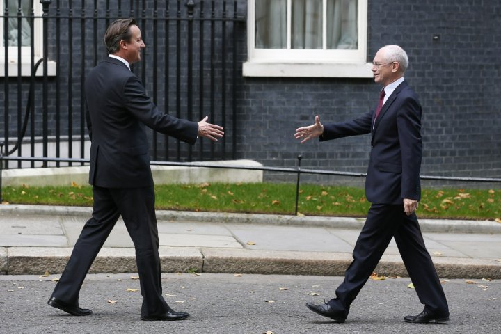 Britain's Prime Minister David Cameron (L) greets the President of the European Council, Herman Van Rompuy, outside 10 Downing Street in central London October 8, 2013