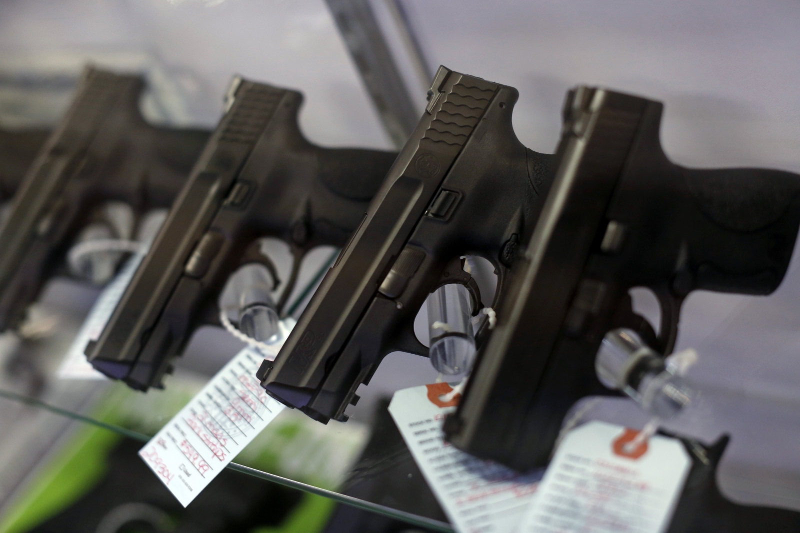 Handguns are seen for sale in a display case at Metro Shooting Supplies in Bridgeton, Missouri