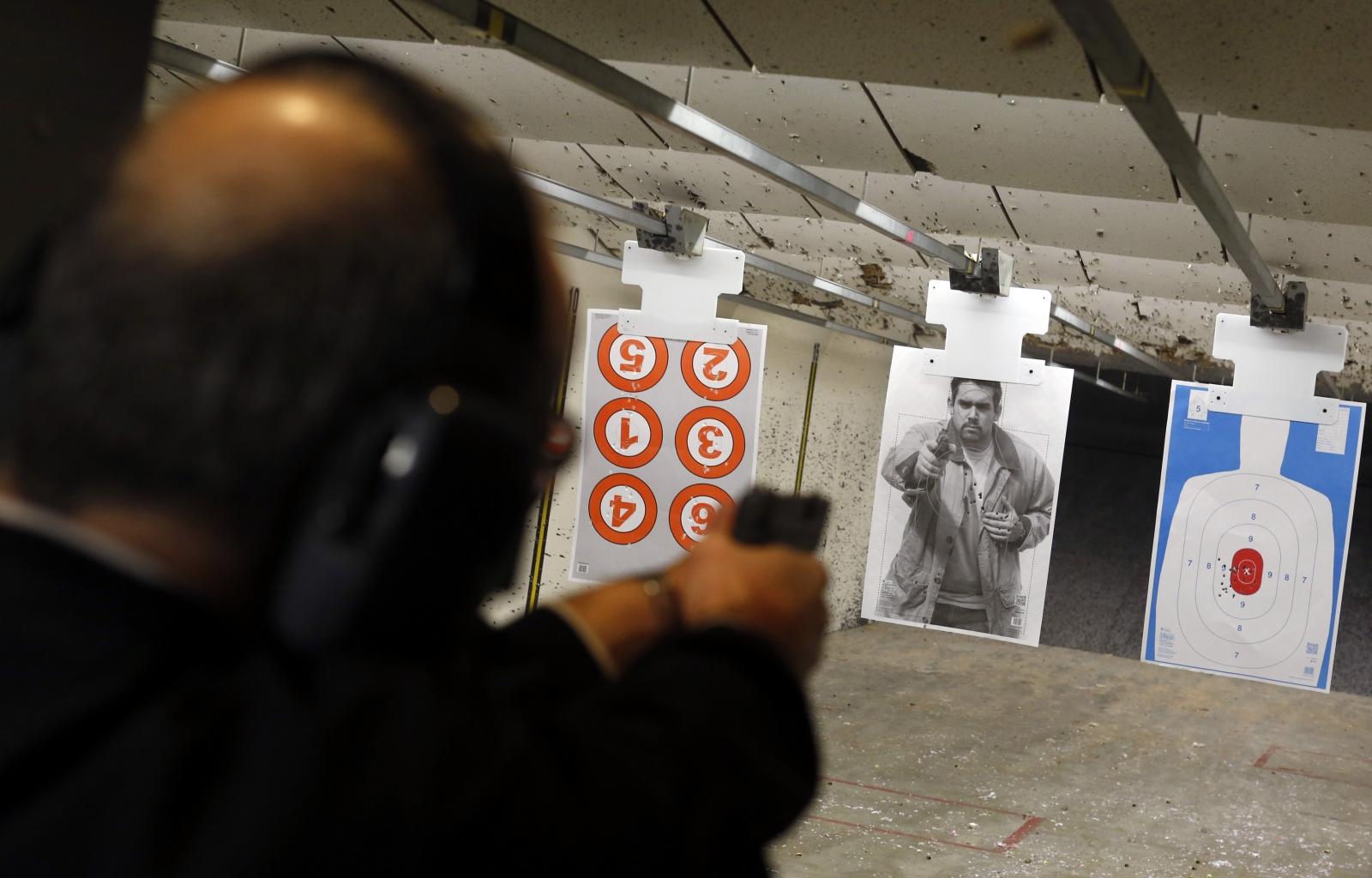 Dennis Krocker fires his handgun at a target at Metro Shooting Supplies' indoor gun range in Bridgeton, Missouri