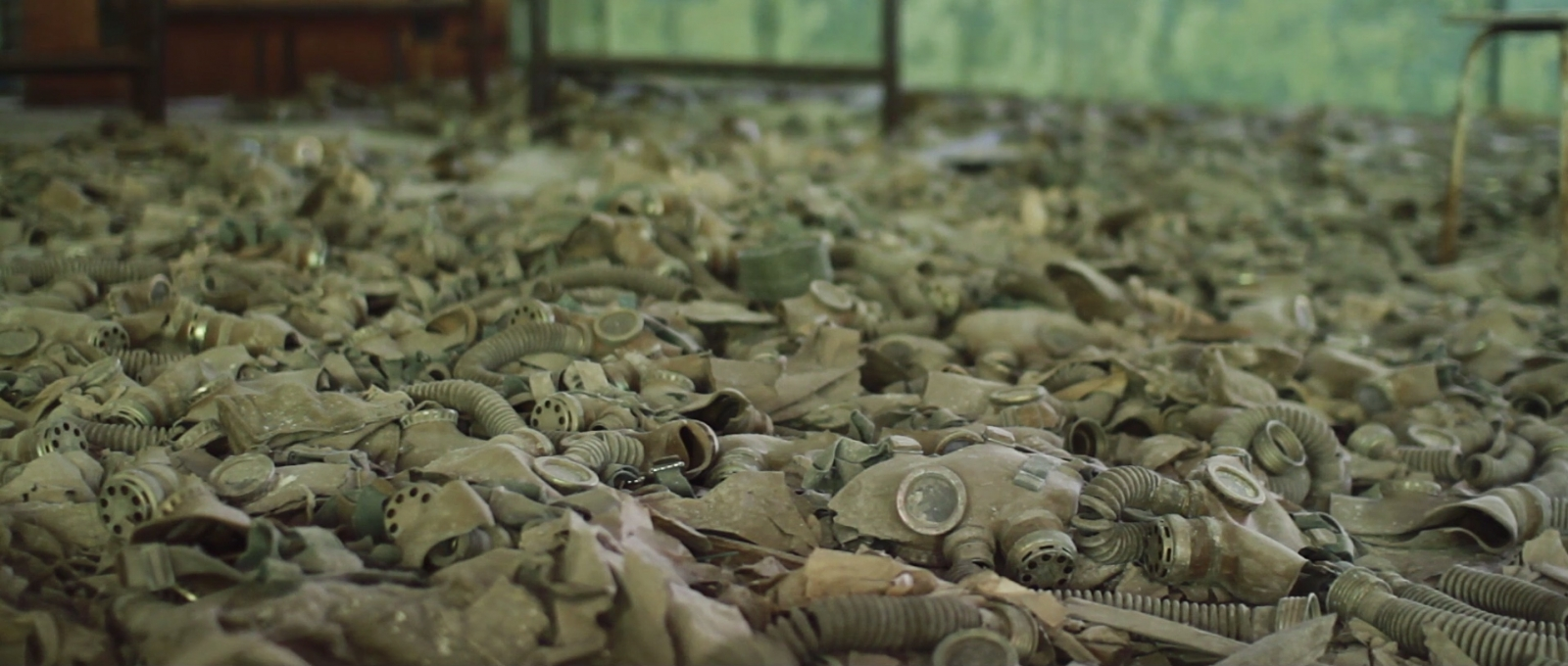 Hundreds of gas masks litter the floors of a building in Pripyat, abandoned by evacuees