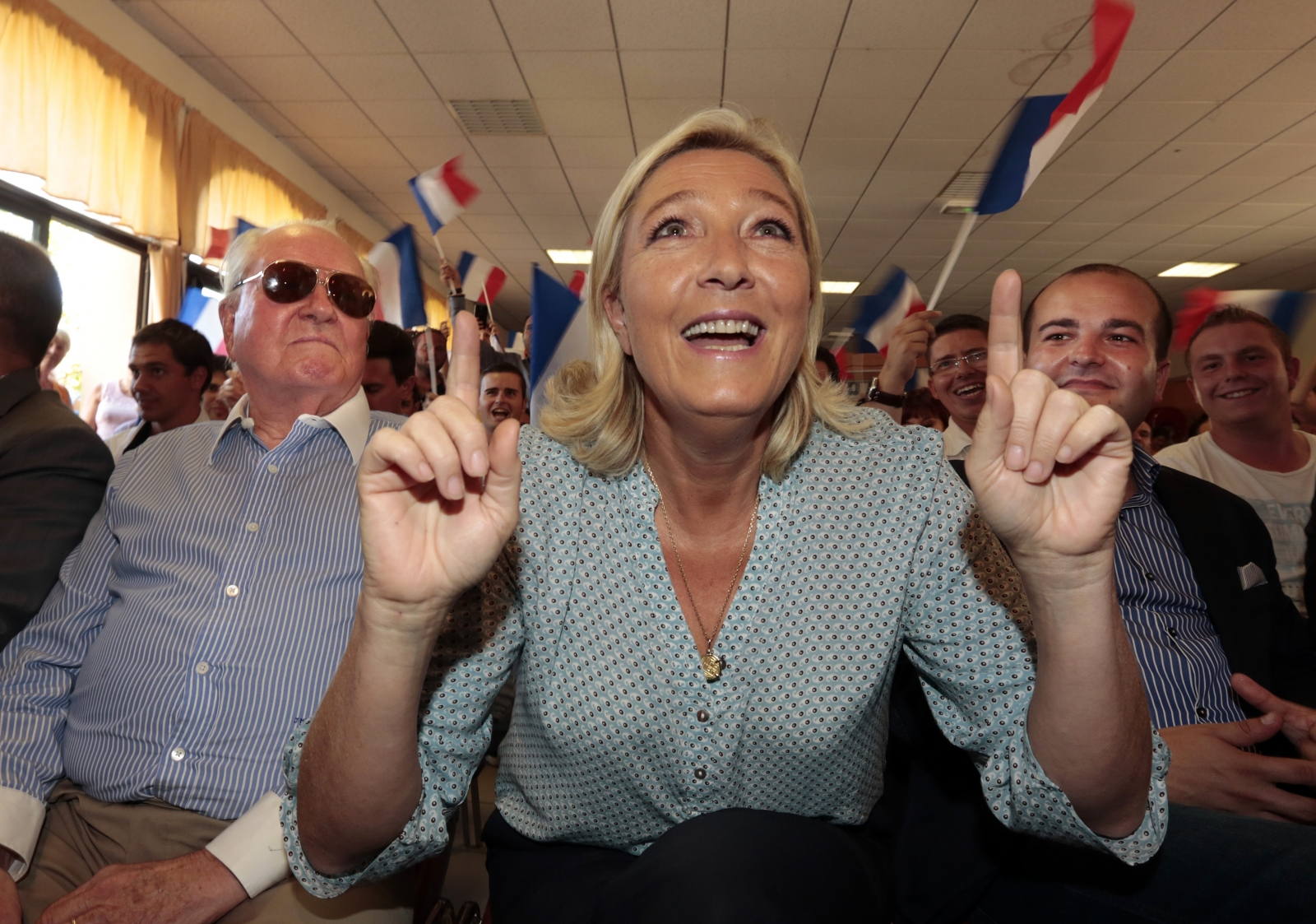 Marine Le Pen, France's National Front political party leader (C)