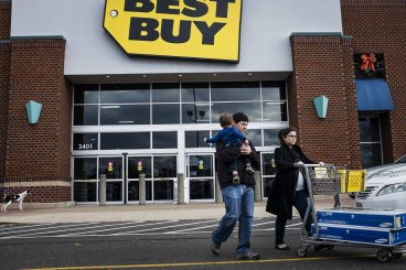 Black Friday shoppers leave a Best Buy store in Alexandria, Virginia