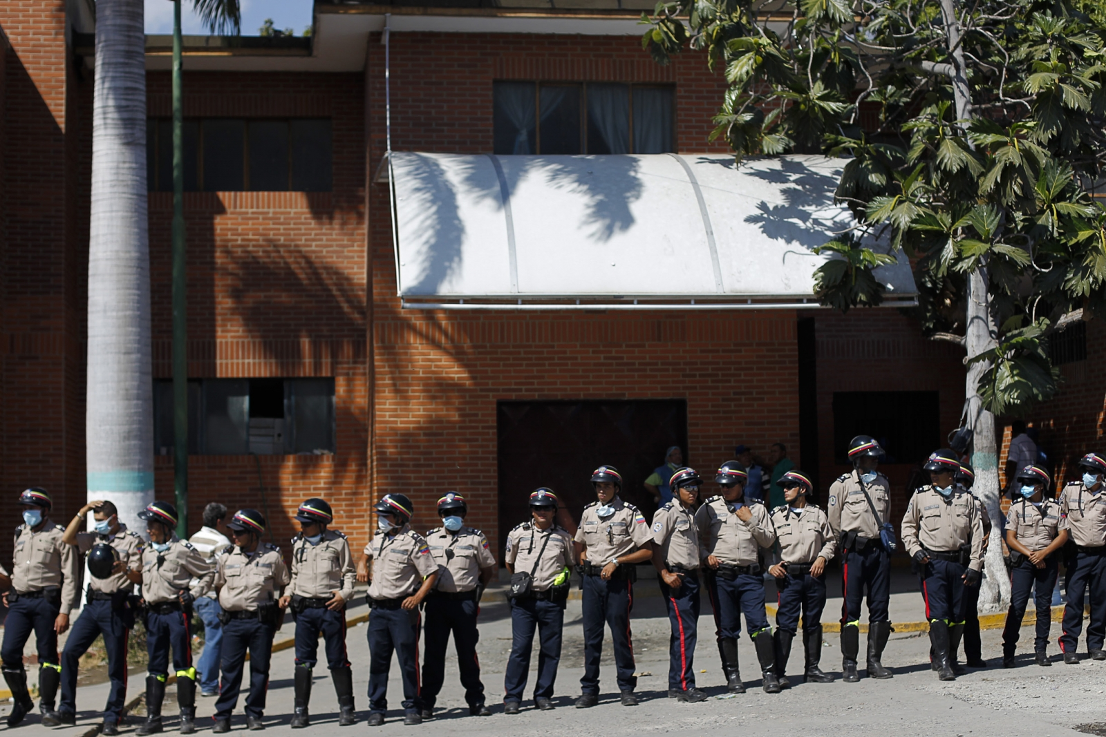 Venezuelan riot police stand guard in front of the morgue in Barquisimeto