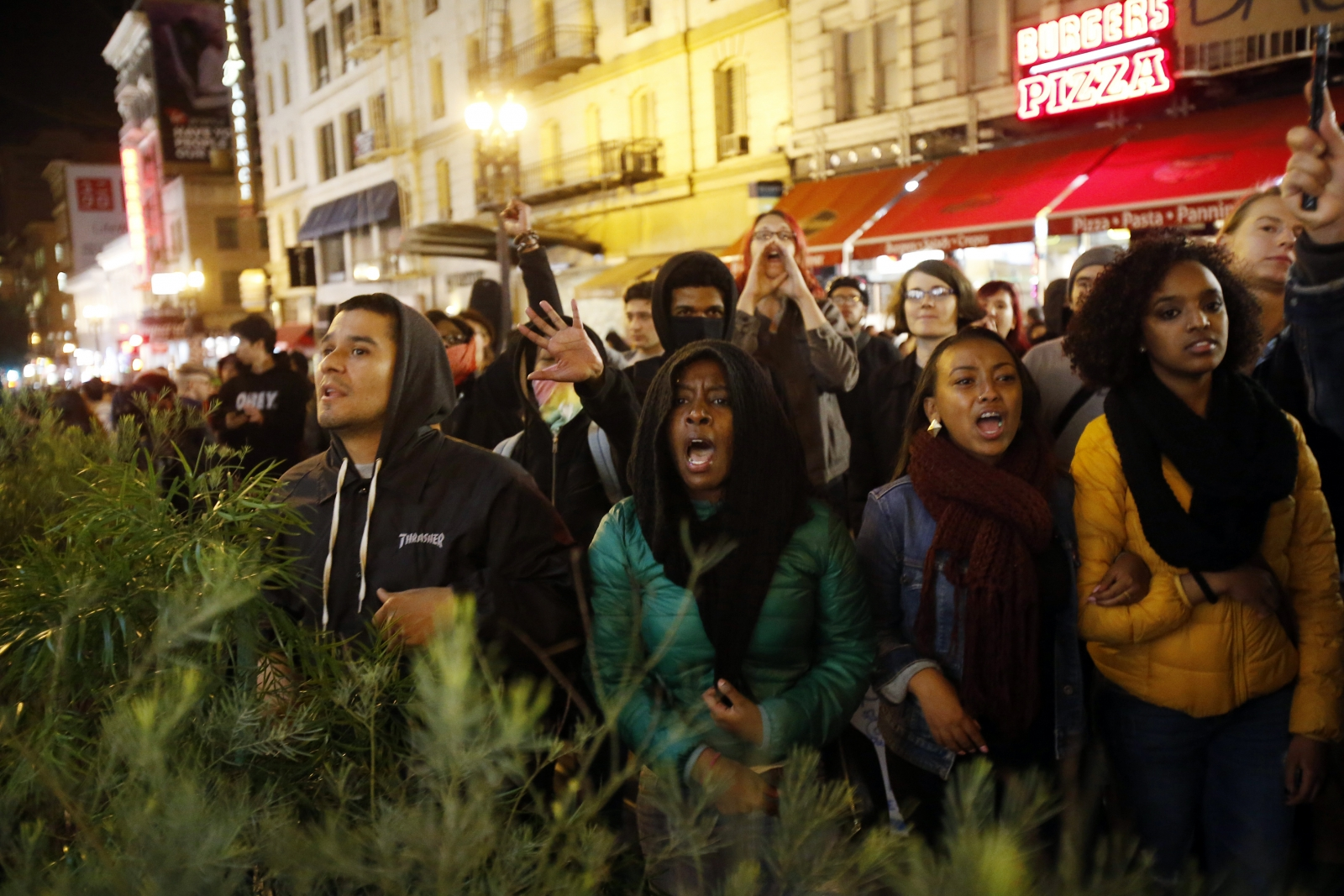 Demonstrators chant against the police during a demonstration against the grand jury decision in the Ferguson, Missouri shooting of Michael Brown