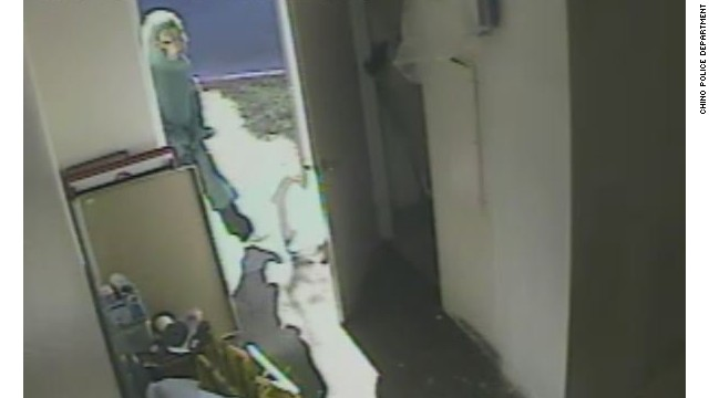 The werewolf masked attacker pictured on CCTV (Handout)